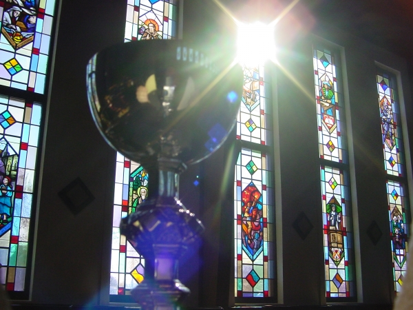 Chalice and Windows With Sun